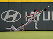 ATLANTA, GA - SEPTEMBER 14:  Left fielder Juan Soto #22 and centerfielder Bryce Harper #34 (left) of the Washington Nationals can't come up with a ball hit by seconc baseman Ozzie Albies #1 of the Atlanta Braves (not pictured) in the sixth inning during the game at SunTrust Park on September 14, 2018 in Atlanta, Georgia.  (Photo by Mike Zarrilli/Getty Images) *** Local Caption *** Juan Soto; Bryce Harper
