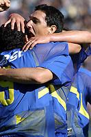 Fotball<br />Argentina<br />19/10/03 BOCA JUNIORS Vs. NUEVA CHICAGO Football - Argentina<br />Tenth match of the Torneo Apertura 2003<br />TEVEZ and BURDISSO are celebrating a goal<br />Foto: Digitalsport