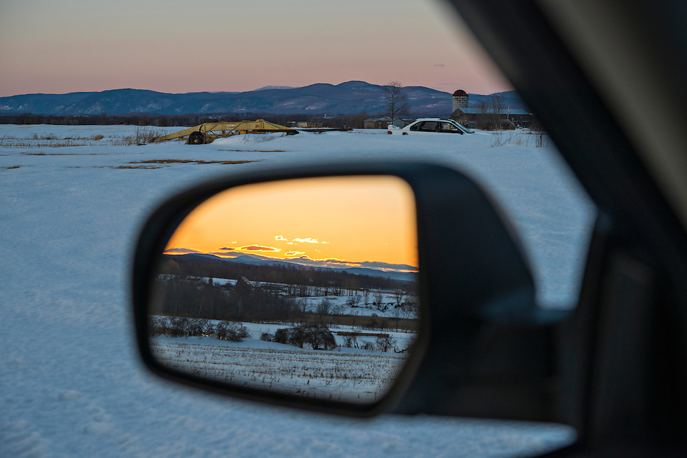 Winter sunset in rearview mirror, Whiting, Vermont