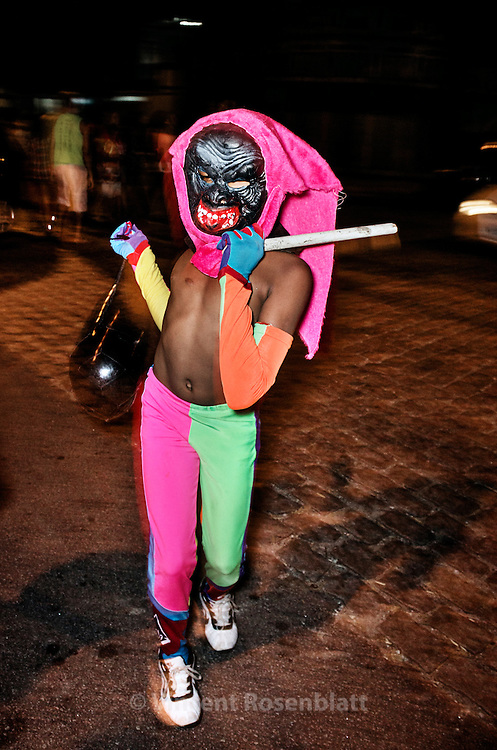"""Kid with basic outfit playing with the ball that gave the names to the gangs of clowns : Bate-Bola (""""Hit-the-ball"""") in the district of Marechal Hermes, zona norte of Rio de Janeiro."""