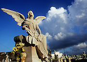 San Juan, Puerto Rico-- A marble angel contrasts sharply against an early storm sky  at a cemetery in the outskirts of Old San Juan, Puerto Rico on March 8, 2000. (Photo by Essdras M Suarez/ EMS Photography)