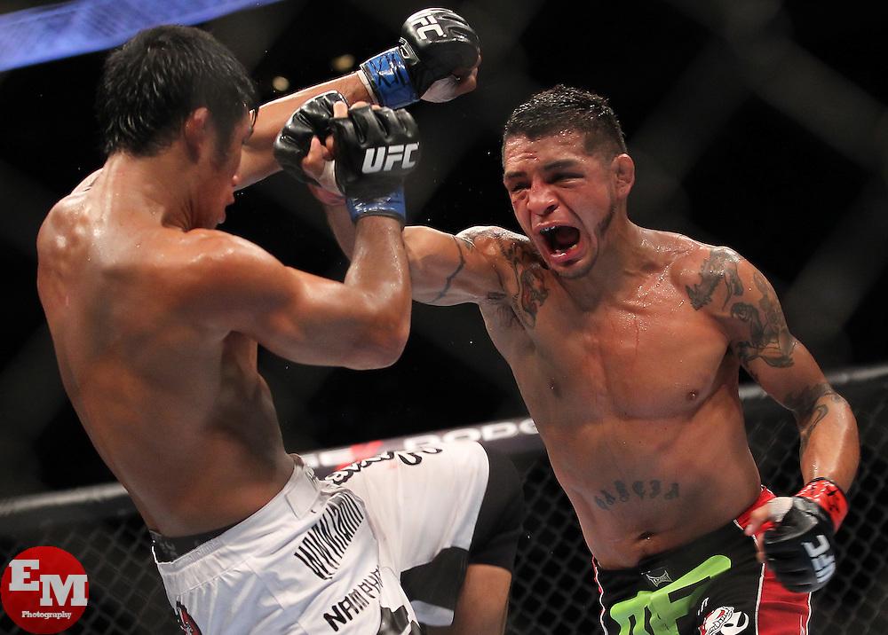 October 8, 2011; Houston, TX.; USA;  Leonard Garcia (black trunks) and Nam Phan (white trunks) during their bout at UFC 136 in Houston.