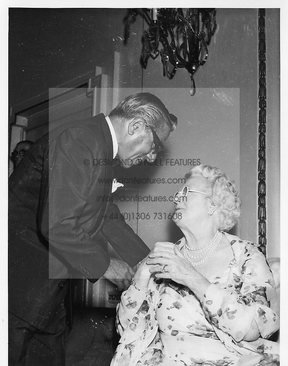 ARISTOTLE ONASSIS and LADY CHURCHILL at a party at The Dorchester Hotel, Park Lane, London in June 1959.<br /> <br /> NON EXCLUSIVE - WORLD RIGHTS