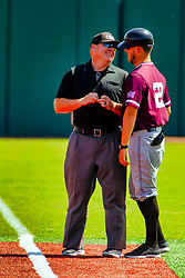 20 May 2019:  Tim Catton and the 1st base Saluki coach have some lighthearted words just before the game. Missouri Valley Conference Baseball Tournament - Southern Illinois Salukis v Illinois State Redbirds at Duffy Bass Field in Normal IL<br />
