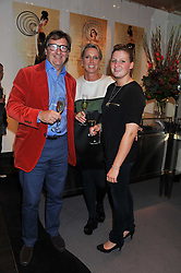 JOHN AYTON and ANNOUSHKA DUCAS with their daughter MARINA AYTON at a private view of jewellery and photographs by Rosie Emerson and Annoushka Ducas entitled Alchemy in association with Ruinart Champagne held at Annoushka, 41 Cadogan gardens, London SW3 on 15th September 2011.