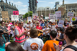 London, UK. 5 July, 2019.  Alex Kenny, NEU Executive member, addresses Jess Phillips, Labour MP for Birmingham Yardley, her 10-year-old son Danny and hundreds of parents and children at a protest organised by the Save Our Schools campaign group in Parliament Square against schools being forced to close early on Fridays due to funding cuts. The school attended by Ms Phillips's children will be closing at lunchtime on Fridays from September. Parents marched from Parliament Square to Downing Street to highlight the government's responsibility to care for and educate the nation's children on a Friday afternoon.