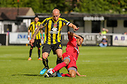 Vadaine Oliver tackles Danny Ellis during the Friendly match between Harrogate Town and York City at Wetherby Road, Harrogate, United Kingdom on 25 July 2015. Photo by Simon Davies.