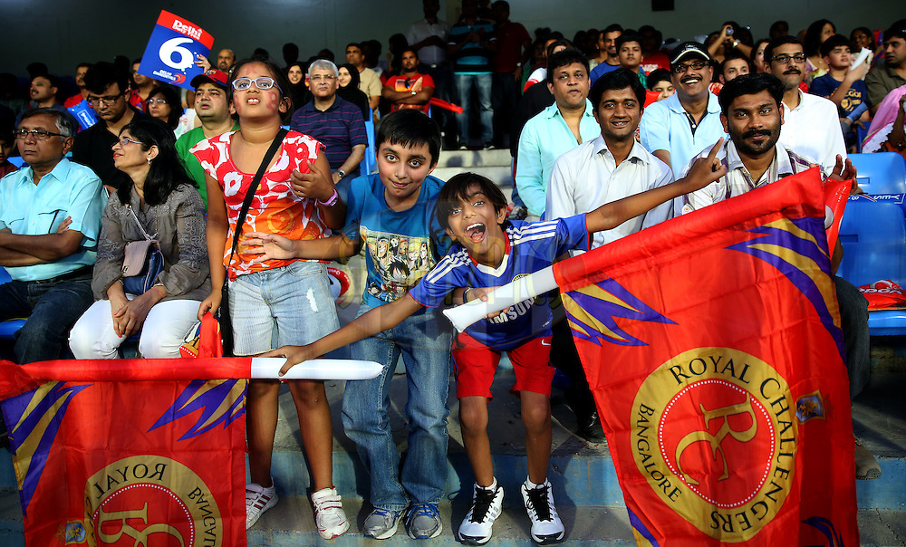 Kids Fan of RCB during match 2 of the Pepsi Indian Premier League Season 7 between the Delhi Daredevils and The Royal Challengers Bangalore held at the Sharjah Cricket Stadium, Sharjah, United Arab Emirates on the 17th April 2014<br /> <br /> Photo by Sandeep Shetty / IPL / SPORTZPICS