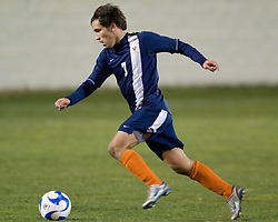 Virginia midfielder Jeremy Barlow (7) dribbles up field against WVU.  The West Virginia Mountaineers defeated the Virginia Cavaliers 1-0 in the second round of the 2007 NCAA Men's Soccer Tournament at Dick Dlesk Stadium in Morgantown, WV on November 28, 2007.