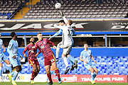 Ipswich Town goalkeeper (on loan from Wolverhampton Wanderers) Will Norris (12) punches clear under pressure from Coventry City striker Max Biamou (9) during the The FA Cup match between Coventry City and Ipswich Town at the Trillion Trophy Stadium, Birmingham, England on 1 December 2019.