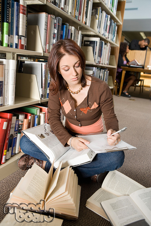 Student Taking Notes in the Library