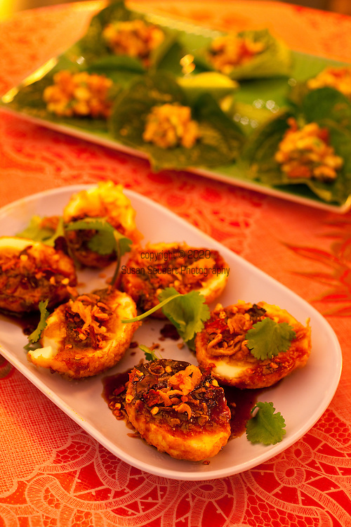 The Whiskey Soda Lounge in Portland, Oregon's SE Neighborhood serves up aahaan kap klaem, the drinking food of Thailand, and the same drinks menu as its mother restaurant, Pok Pok. Chef Chew's Khai Luuk Khoei: deep-fried boiled farm eggs with sweet & spicy tamarind sauce and fried shallots.