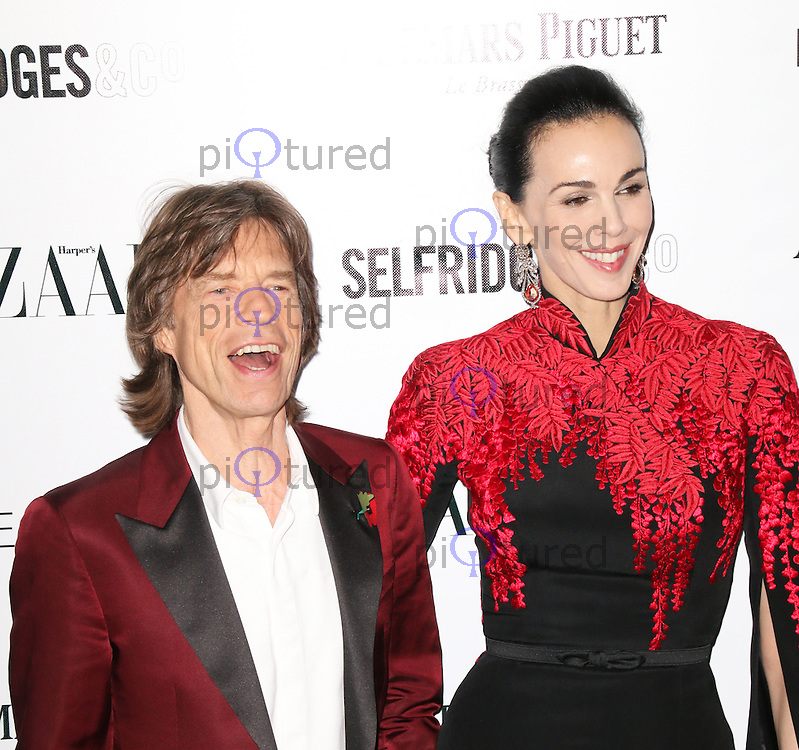 Mick Jagger; L'Wren Scott, Harper's Bazaar Women of the Year Awards, Claridge's Hotel, London UK, 05 November 2013, Photo by Richard Goldschmidt