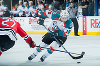 KELOWNA, CANADA - APRIL 8: Brad Ginnell #27 of the Portland Winterhawks stick checks Dillon Dube #19 of the Kelowna Rockets as he skates with the puck on April 8, 2017 at Prospera Place in Kelowna, British Columbia, Canada.  (Photo by Marissa Baecker/Shoot the Breeze)  *** Local Caption ***
