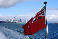 Auckland, shoreline, with New Zealand flag in the foreground. 20104235458..Copyright Image from Victor Patterson, 54 Dorchester Park, Belfast, United Kingdom, UK. Tel: +44 28 90661296. Email: victorpatterson@me.com; Back-up: victorpatterson@gmail.com..For my Terms and Conditions of Use go to www.victorpatterson.com and click on the appropriate tab.