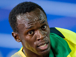 Usain Bolt of Jamaica after winning the gold medal in the men's 100 Metres Final during day two of the 12th IAAF World Athletics Championships at the Olympic Stadium on August 16, 2009 in Berlin, Germany. Bolt set a new World Record of 9.58. (Photo by Vid Ponikvar / Sportida)