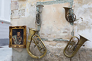 Old musical instruments hang from a wall opposite an antique shop in the rural Slovenian town of Radovljica, on 22nd June 2018, in Radovljica, Slovenia.