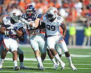 Auburn wide receiver Emory Blake (80) is tackled by Mississippi defensive back Senquez Golson (21) and Mississippi defensive back Brishen Mathews (13) as Auburn wide receiver Jaylon Denson (89) blocks at Vaught-Hemingway Stadium in Oxford, Miss. on Saturday, October 13, 2012. (AP Photo/Oxford Eagle, Bruce Newman)..