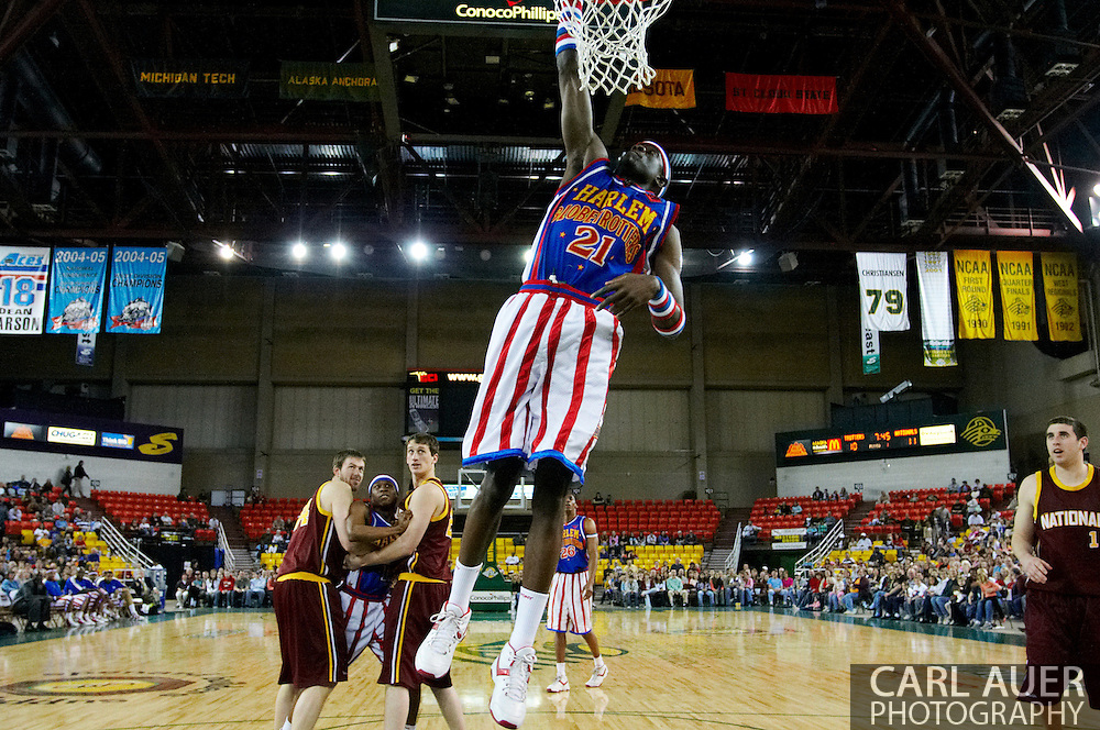 """05 May 2006: Kevin """"Special K"""" Daley goes for a dunk during the Harlem Globetrotters vs the New York Nationals at the Sulivan Arena in Anchorage Alaska during their 80th Anniversary World Tour."""