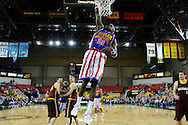 "05 May 2006: Kevin ""Special K"" Daley goes for a dunk during the Harlem Globetrotters vs the New York Nationals at the Sulivan Arena in Anchorage Alaska during their 80th Anniversary World Tour."