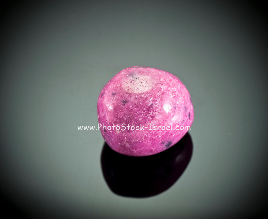Cutout of a rhodonite gemstone on black background