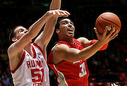 New Mexico forward Drew Gordon (32) attempts to score against Utah center David Foster (51) during the second half of an NCAA college basketball game, Wednesday, Jan. 19, 2011, in Salt Lake City, Utah. Utah defeated New Mexico 82-72. (AP Photo/Colin E Braley)