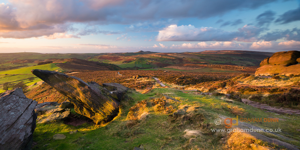 Golden, autumnal, evening light at Roach End. Looking towards a distant Shutlingsloe. A classic gritstone scene from the South-Western flank of the Peak District National Park, Staffordshire, England, UK. October. Autumn.