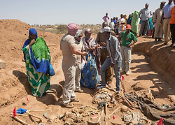 © Licensed to London News Pictures. 7/4/2015. **Warning:  Images contain content of a graphic nature **  Garbiley, Somaliland.  Relatives enter a mass grave with forensic students to help identify the victims of the Somali civil war.  The relatives inspected items of the clothing that still remains. <br /> <br /> From 1969 to 1990,  president and military dictator Siad Barre oversaw a campaign of atrocities to quash separatist movements in the 1980s.  The Somali Armed Forces targeted civilians in the northwest, culminating in the bloody 1988 siege of the regional capital Hargeisa and surrounding nomadic communities, which claimed an estimated 50,000 civilian lives.   Photo credit : Alison Baskerville/LNP