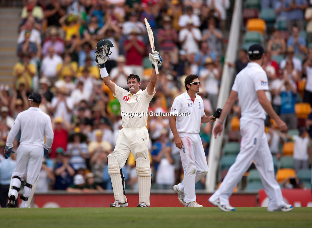 Michael Hussey celebrates his century during his 195 in the first Ashes Test Match between Australia and England at the Gabba, Brisbane. Photo: Graham Morris (Tel: +44(0)20 8969 4192 Email: sales@cricketpix.com) 27/11/10
