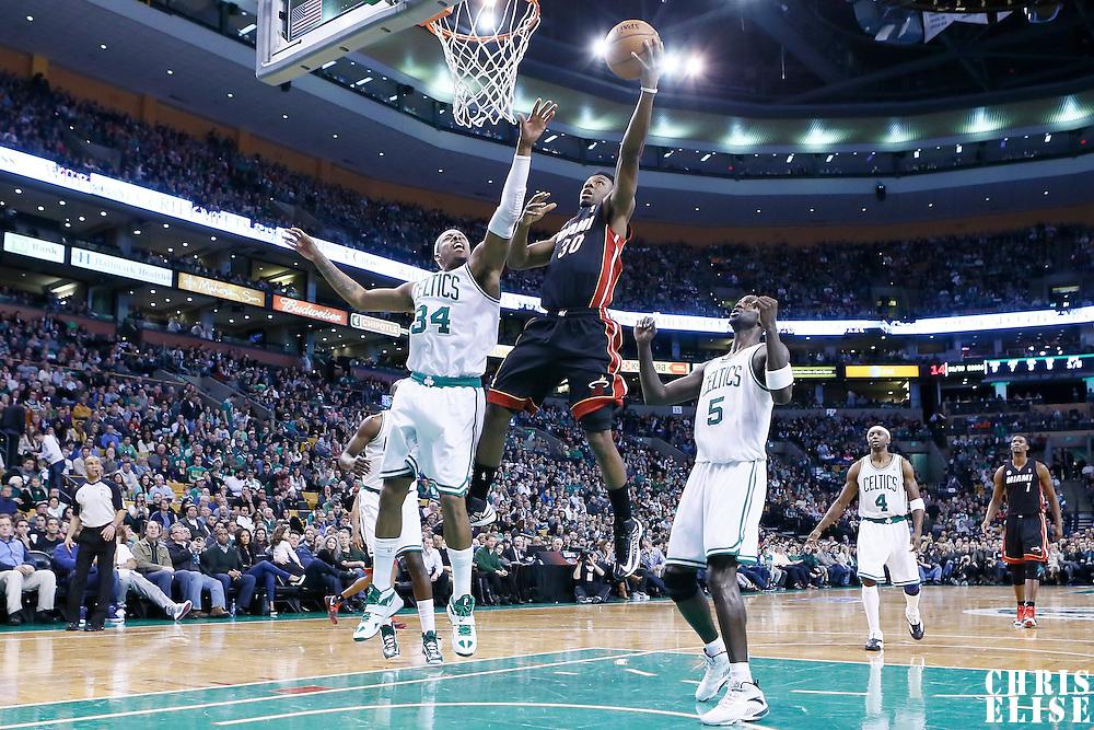 27 January 2013: Miami Heat point guard Norris Cole (30) goes for the layup against Boston Celtics small forward Paul Pierce (34) during the Boston Celtics 100-98  2OT victory over the Miami Heat at the TD Garden, Boston, Massachusetts, USA.