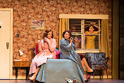 "© Licensed to London News Pictures. 14/05/2014. London, England. L-R: Kate Valentine as Fiordiligi, Christine Rice as Dorabella and Mary Bevan as Despina. Dress rehearsal of the Wolfgang Amadeus Mozart opera ""Così fan tutte"" at the London Coliseum. A new ENO production of Mozart's dark comedy set in the world of a 1950's Coney Island funfair. With Kate Valentine as Fiordiligi, Christine Rice as Dorabella, Marcus Farnsworth as Guglielmo, Randall Bills as Ferrando, Mary Bevan as Despina and Roderick Williams as Don Alfonso. Directed by Phelim McDermott, Conductor: Ryan Wigglesworth. Co-produced by the English National Opera and the Metropolitan Opera, New York. In collaboration with Improbable. 12 performances from 16 May to 6 July 2014. Photo credit: Bettina Strenske/LNP"