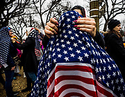 Laila Noureldin adjusts a head scarf on one of the many protesters at the Women's March. Noureldin gave away scarves to participants who wished to show solidarity with musilm women during the march. Washington DC 21 january 2017
