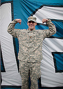 Gonzaga ROTC Officer Major Scott Smiley raising the 12th Man Flag for the Seattle Seahawks Veteran's Day game on Nov. 9.<br />