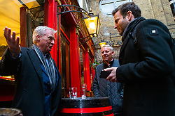Financial PR Director Andy Fleming, left, and Lobbyist Dan Guthrie, centre, talk with Bild journalist Philip Fabian about Brexit at the Ship and Shovell pub in Charing Cross, in London. London, January 16 2019.