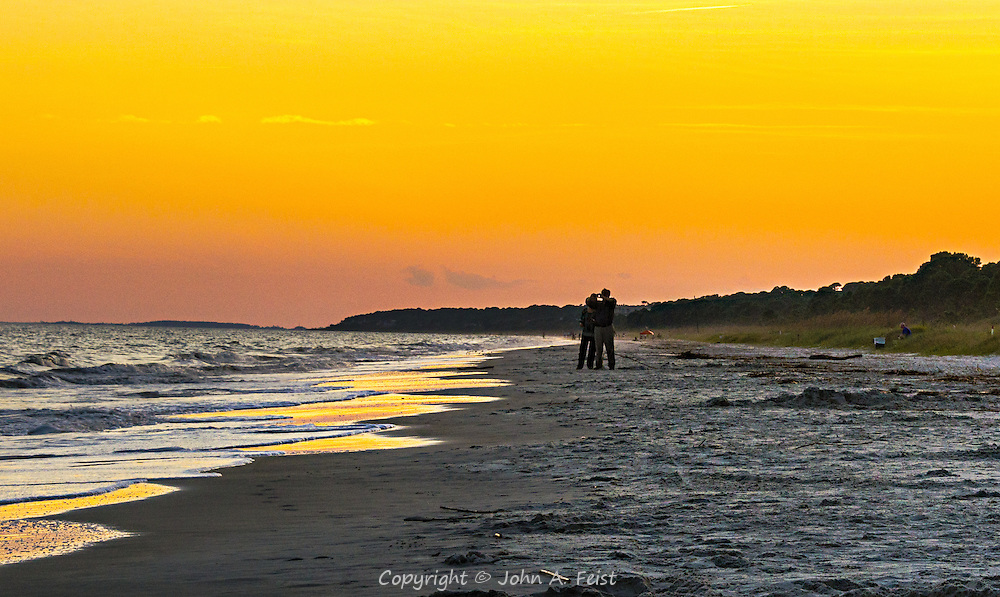 People seem to be a little more at ease on the beach.  This couple is enjoying the colorful sunset.  I think they were using a camera phone and didn't care that I was including them in the picture!