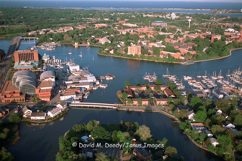 Aerial view of downtown Hampton with the Air & Space Museum on left.  Hampton Roads/Newport News Virginia.  The mouth of Chesapeake Bay can be seen in the upper distance and Hampton University at middle right (below the water tower to the water.)