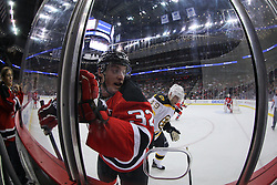 Jan 4, 2012; Newark, NJ, USA; Boston Bruins center Tyler Seguin (19) hits New Jersey Devils defenseman Matt Taormina (32) during the first period at the Prudential Center.