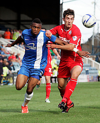Peterborough United's Britt Assombalonga in action with Crawley Town's Joe Walsh  - Photo mandatory by-line: Joe Dent/JMP - Tel: Mobile: 07966 386802 31/08/2013 - SPORT - FOOTBALL -  London Road Stadium - Peterborough - Peterborough United V Crawley Town - Sky Bet League One