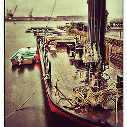 """The Gundalow docked at Prescott Park in Portsmouth, New Hampshire. Portsmouth Naval Shipyard is in the distance. iPhone photo - suitable for print reproduction up to 8"""" x 12""""."""