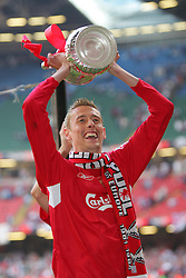 CARDIFF, WALES - SATURDAY, MAY 13th, 2006: Liverpool's Peter Crouch celebrates winning the FA Cup after a penalties victory over West Ham United during the FA Cup Final at the Millennium Stadium. (Pic by David Rawcliffe/Propaganda)