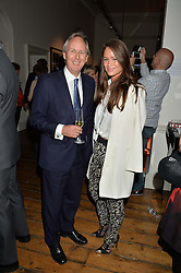 CHARLIE MAYHEW and LEXI BOWES LYON at a private view of photographs by renowned wildlife photographer David Yarrow in aid of TUSK entitled 'Wild Encounters' held at Somerset House on 19th September 2016.