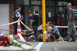 March 17, 2019 - Christchurch, New Zealand - Local residents attend to pay respects to victims of the mosque attacks outside the Linwood Masjid mosque in Christchurch on March 16, 2019. At least 49 people dead and more than 40 people injured following attacks on two mosques in  Christchurch. The national security threat level has been increased from low to high for the first time in New Zealand's history after this attack. (Credit Image: © Sanka Vidanagama/NurPhoto via ZUMA Press)