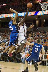 Virginia's Solomon Tat (45) shoots over Duke's Greg Paulus (3) and Gerald Henderson (15). The University of Virginia Cavaliers beat the #8 ranked Duke University Blue Devils 68-66 in overtime at the John Paul Jones Arena in Charlottesville, VA on February 1, 2007...