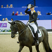 Isabell Werth (GER) and Weihegold OLD win the Grand Prix at the FEI World Cup Dressage Finals in Omaha, Nebraska.