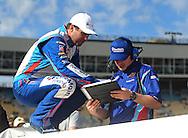 Nov. 12 2011; Avondale, AZ, USA; NASCAR Nationwide Series driver Elliott Sadler (2) talks with a member of his crew during qualifying for the Wypall 200 at Phoenix International Raceway. Mandatory Credit: Jennifer Stewart-US PRESSWIRE