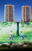 An advertisement features an elderly couple riding bikes in a luxury housing development in Dong Li lake near Tianjin.