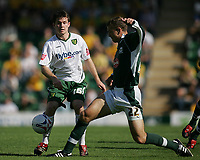Photo: Lee Earle.<br /> Plymouth Argyle v Norwich City. Coca Cola Championship. 23/09/2006. Argyle's Paul Connolly (R) tackles Patrick Boyle.