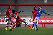 David Sesay of Crawley Town tackles Michael Rose of Macclesfield Town during the EFL Sky Bet League 2 match between Crawley Town and Macclesfield Town at The People's Pension Stadium, Crawley, England on 23 February 2019.