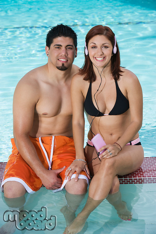 Young Couple Relaxing in Swimming Pool, Portrait