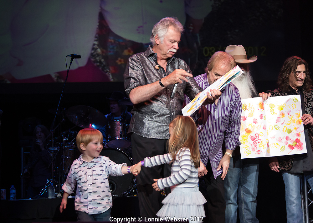 Singer Joe Bonsall of The Oak Ridge Boys receives a large card signed by the children of Sugar Grove Developmental Day School during a benefit concert in Boone NC